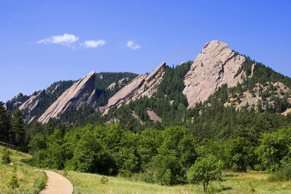 "The sandstone ""Flatirons"" form the western edge of Boulder, with lots of rock climbing and hiking nearby."